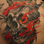 Black and grey skull and flames tattoo