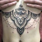 underboob tattoo, mandala style tattoo henna style tattoo, girly tattoo, feminine tattoo, black & grey tattoo, zombie tattoo helsinki, zombie tattoo salla