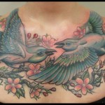 birds and flowers chestpiece color tattoo