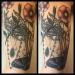 neo traditional skeleton hand and flowers tattoo